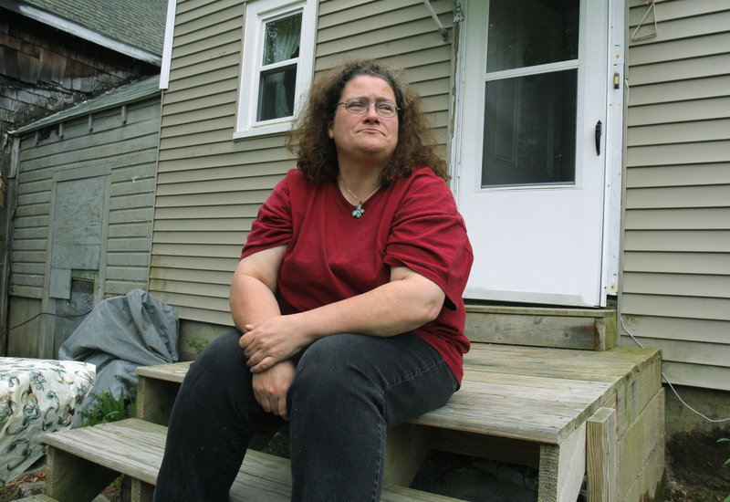 Donna Petelis sits on her stoop in Ossipee, N.H.