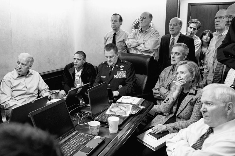 President Barack Obama and Vice President Joe Biden, seated at left, join members of the national security team for an update in the Situation Room of the White House on May 1 on the mission against Osama bin Laden. Seated at right are Secretary of State Hillary Rodham Clinton and Defense Secretary Robert Gates.