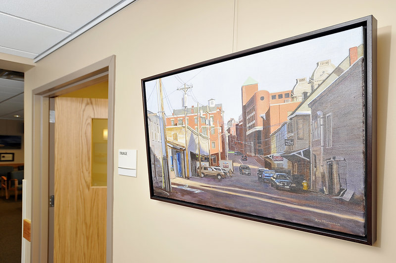 An Ann Mohnkern painting of Portland's Custom House Wharf hangs in the new health-care center in Yarmouth. Works by another artist will go up in mid-June.