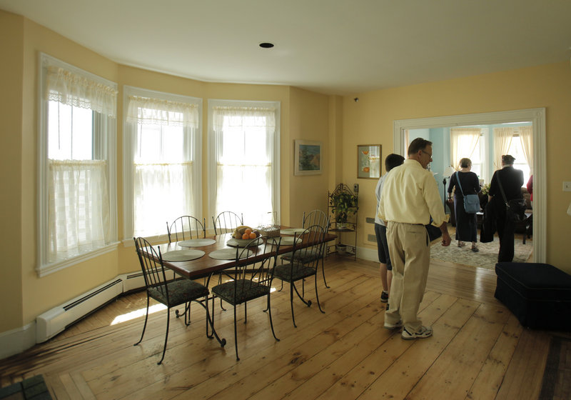 Visitors tour Shalom House's group home, the Seth Jordan House, on O'Brion Street in Portland.