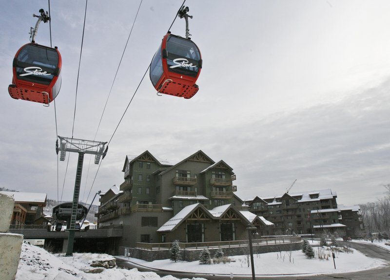 About 300 condo owners at the Stowe Mountain Resort are suing affiliates of American International Group, which owns the resort. Owners say they put down 20 percent deposits on units in 2005, but when changes in fees came just before closing in 2008, they weren't given a chance to back out.