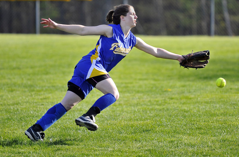 Sarah Collmus of Falmouth stretches to try and reach a hard-hit ball in right field. The Yachtsmen improved their record to 7-2 and dropped Yarmouth to 8-2.