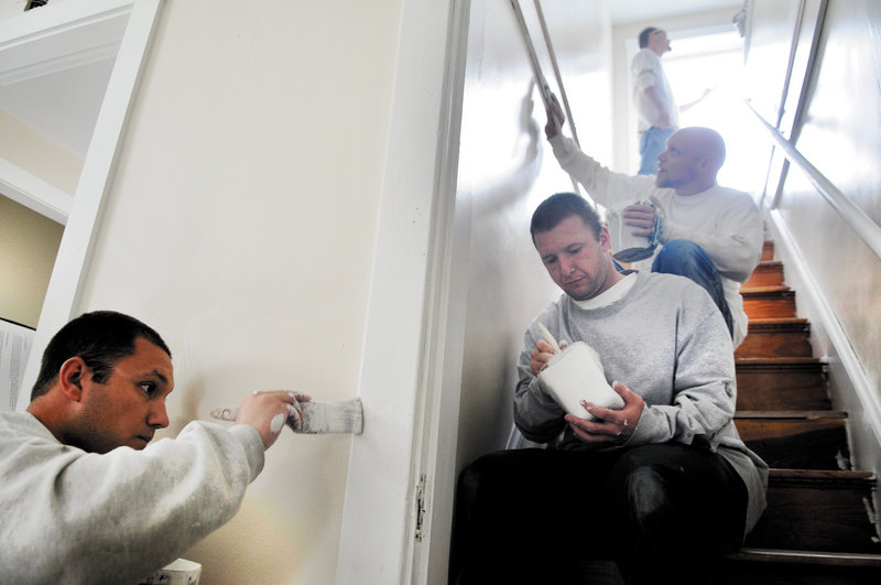 Inmates from the Central Maine Pre-Release Center in Hallowell paint a stairwell last week at the Bread of Life Shelter in Augusta. From left are Joe Oliveira, Danny Logan, Dallas Sizemore and Adam MaGuire. Work crews from the center also have helped set up for the Maine International Film Festival in Waterville and refurbished the Augusta Police Department.