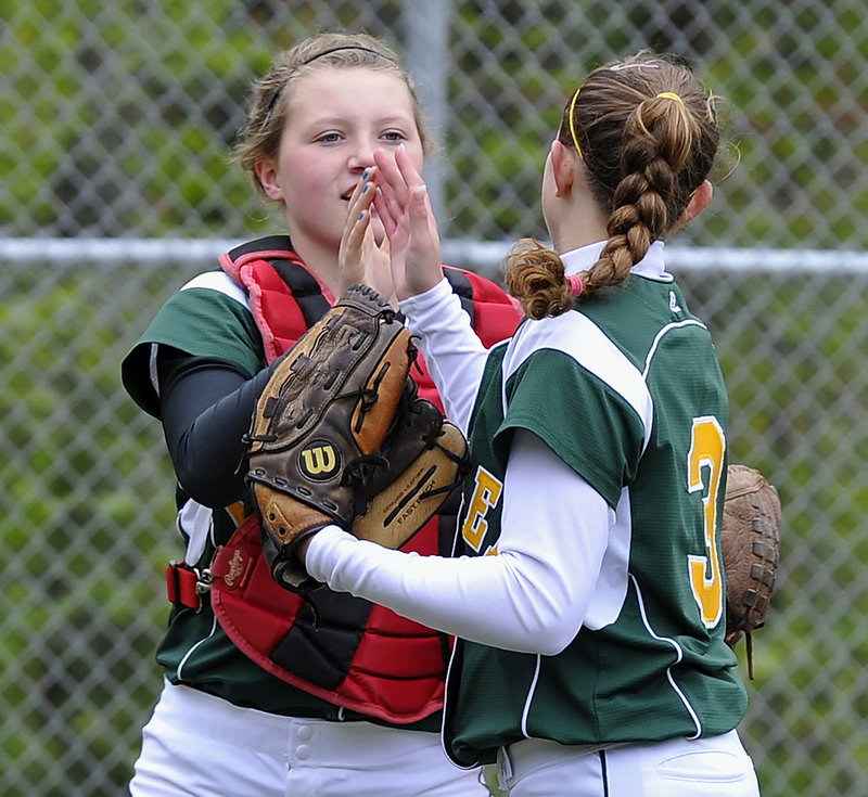 McAuley catcher Sam Schildroth exchanges a high-five with pitcher Jen Field after Field escaped a bases-loaded jam Monday against Gorham. Field allowed just two hits in a 12-0 victory.