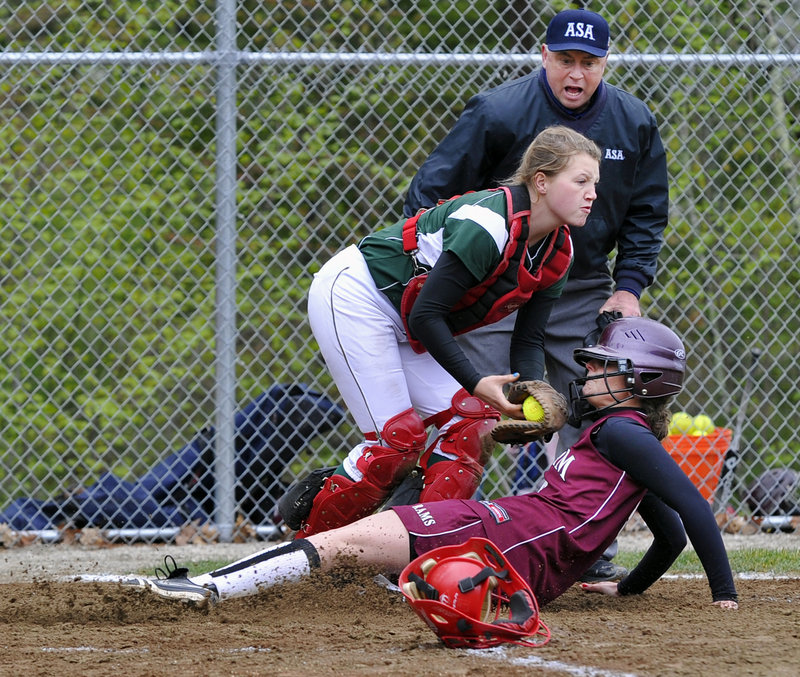 Sam Schildroth tags out Gorham's Leaha Keene after Keene tried to score on a ball hit to McAuley third baseman Maura Ester.