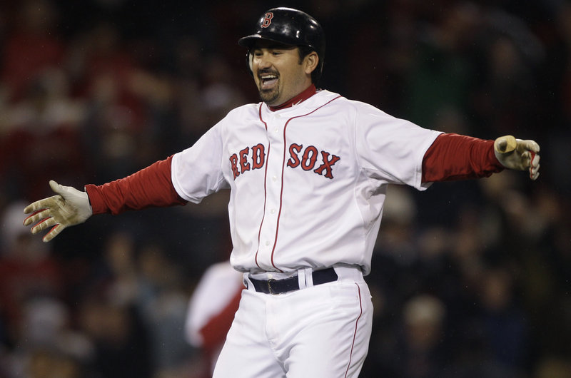 Adrian Gonzalez celebrates his two-run double in the ninth Monday night that sent the Red Sox to an 8-7 victory over the Orioles.