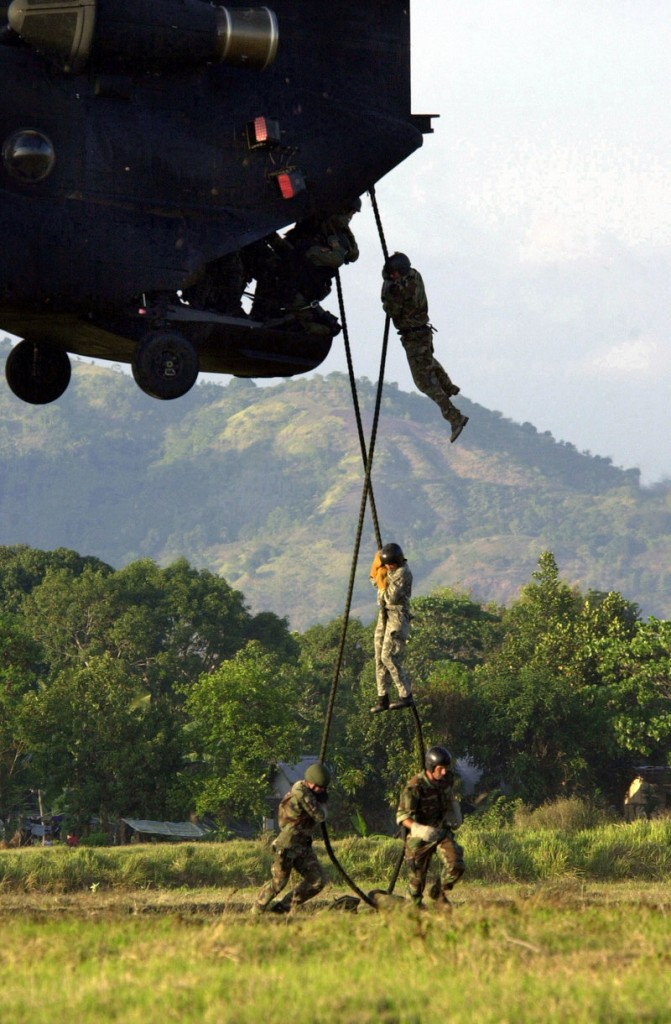 Navy SEALs help train Philippine soldiers in this 2002 file photo. Today, some falsely claim to be SEALs, which one reader says is a symptom of a wider lack of integrity.