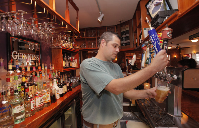 Bartender Kenny Kumka serves up a draft beer at Stutesy's Pub & Grille in Moody. Stutesy's also mixes sports-inspired drinks, such as the Sweet Caroline and the Goombay Smash.