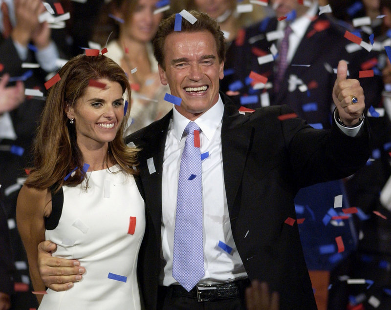 "Former Gov. Arnold Schwarzenegger and his wife, Maria Shriver, celebrate his victory in the California gubernatorial recall election in Los Angeles in 2003. He has revealed that he fathered a child with a member of his household staff ""over a decade ago."""