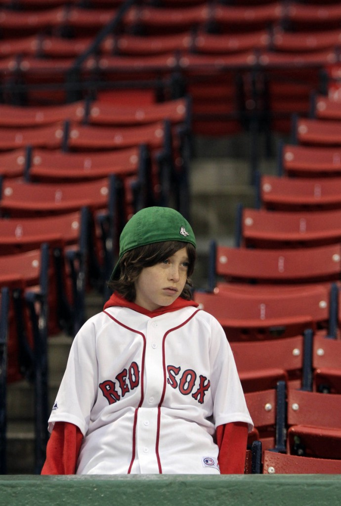 Brooks Fletcher, 9, of Lake Placid, N.Y., hears the bad news: Boston's game against Baltimore at Fenway Park was postponed because of rain.