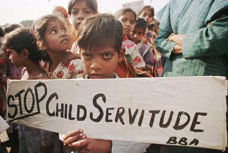 India's exploitation of child labor has been going on for decades and can be found throughout the economy, from sweatshops and factories to mines and roadside businesses. This photo was taken during a protest held in New Delhi in 1996, but tens of thousands of children remain vulnerable.