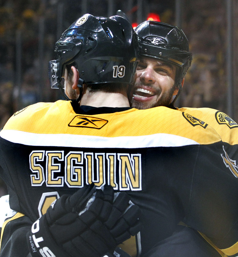 Tyler Seguin is hugged by teammate Nathan Horton after a second-period goal – one of his two Tuesday.