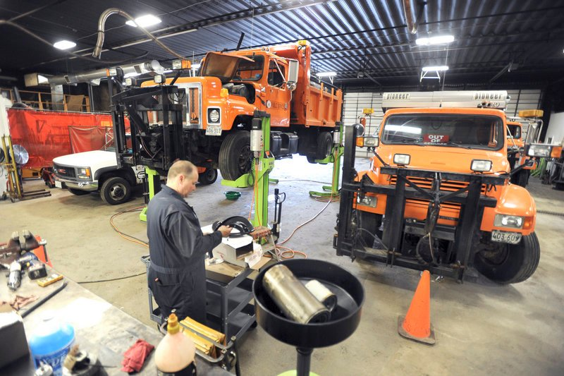 Lead technician Mark Poitras works on trucks at the Westbrook Public Services Department on Thursday. The department is holding an open house Saturday to show residents how crowded its facilities are, with hopes to build a new one in 2013.