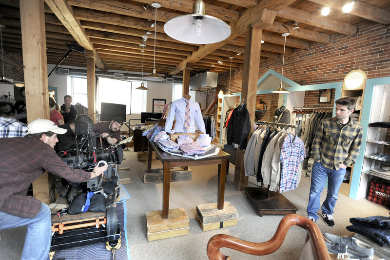 An independent film crew shoots a scene with actor Adam Scott inside Joseph's Clothing Co. on Fore Street in Portland on Thursday. The crew, and Scott worked for about two hours after an earlier shoot at the Brian Boru bar.