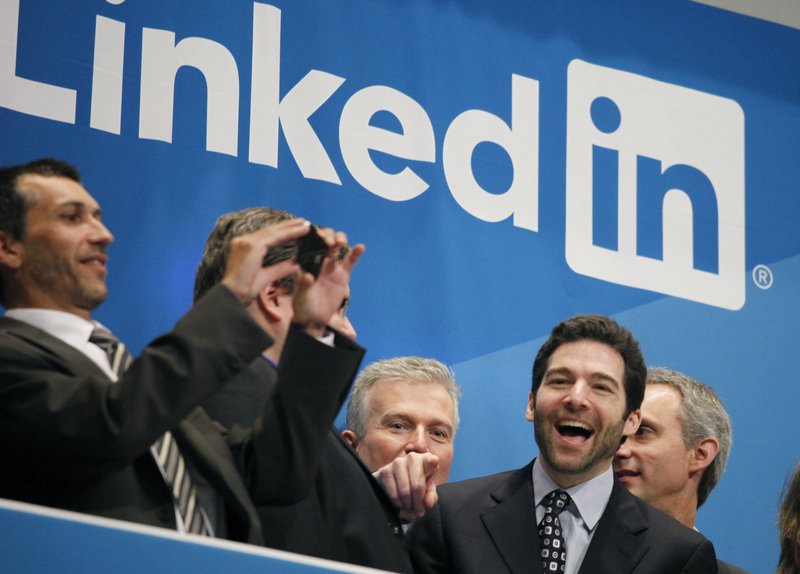 Jeff Weiner, second from right, LinkedIn's CEO, celebrates the company's listing Thursday at the New York Stock Exchange. LinkedIn, based in Mountain View, Calif., is an Internet-based social networking rolodex for business people.