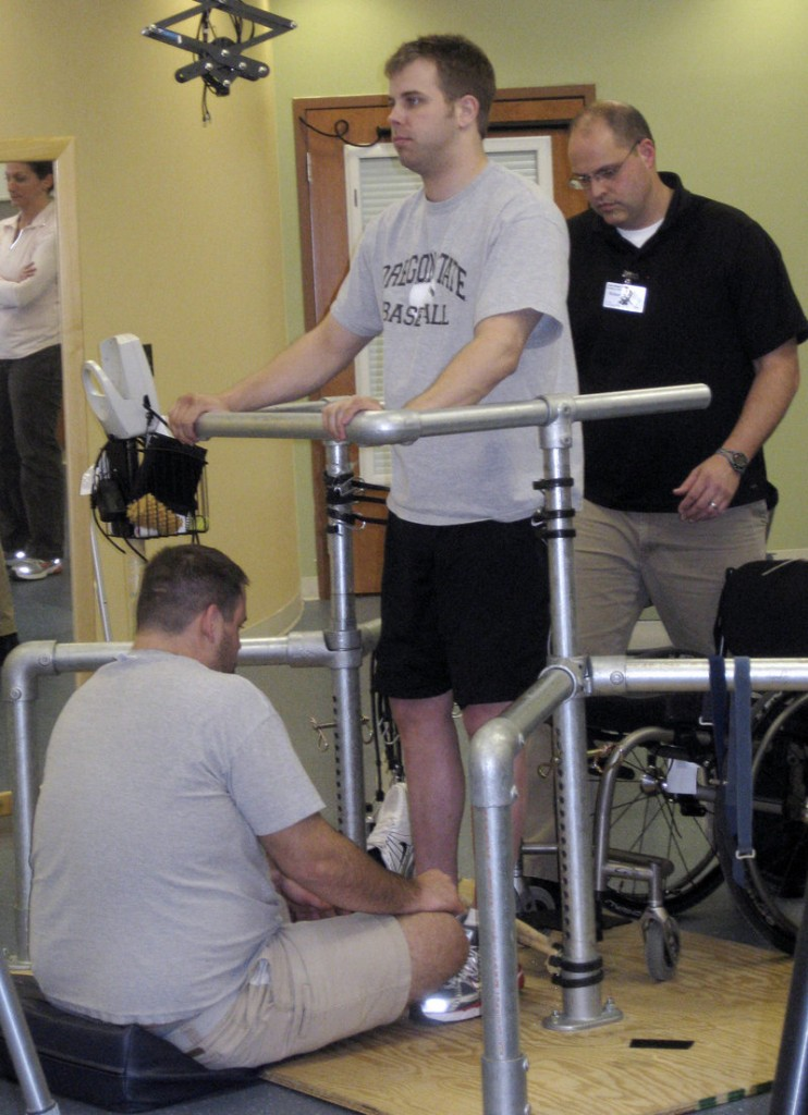 Rob Summers, paralyzed below the waist, undergoes intensive physical therapy in Louisville, Ky. in 2010.