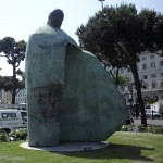 A sculpture portraying Pope John Paul II outside Rome's Termini train station is drawing criticism. The mayor says the city may consider removing the 16-foot-tall statue in response to the negative reaction.