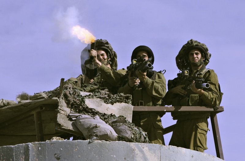 Israeli soldiers fire tear gas at Palestinian protesters at the Qalandiya checkpoint Friday. President Obama on Thursday finally uttered the words that the Palestinians had been waiting to hear for two years: that the basis for border talks with Israel is the pre-1967 war line.