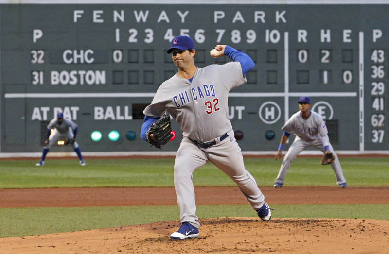 Cubs starter Doug Davis delivers a pitch Friday night in his club's first game at Fenway Park since the 1918 World Series, which Boston won in six games.