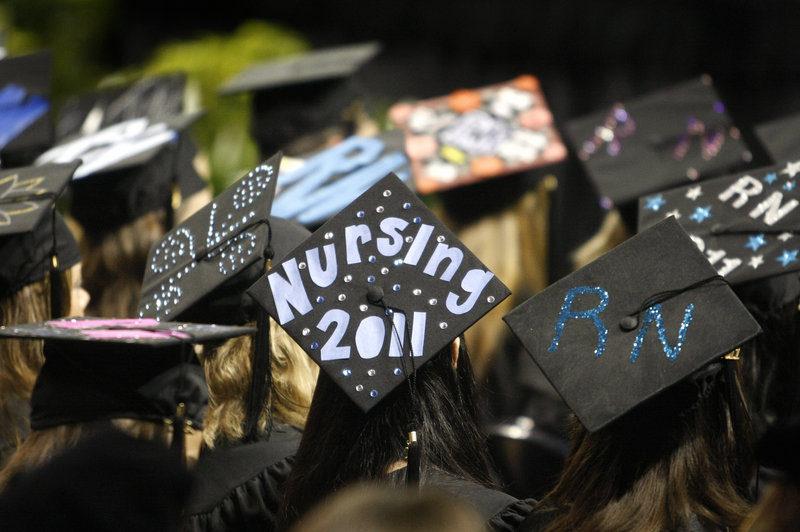Nursing school graduates show their pride at the University of New England's commencement at the Cumberland County Civic Center in Portland on Saturday.