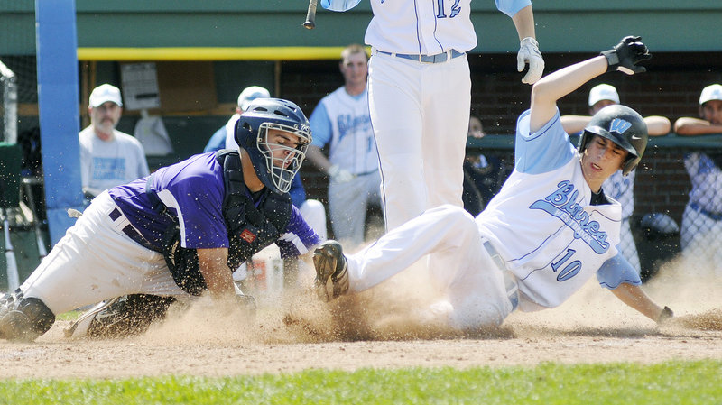 Joe Quinlan of Westbrook slides past a tag applied by Deering catcher John Miranda to score on a steal of home during the fourth inning of unbeaten Westbrook's 6-0 victory Saturday at Hadlock Field.