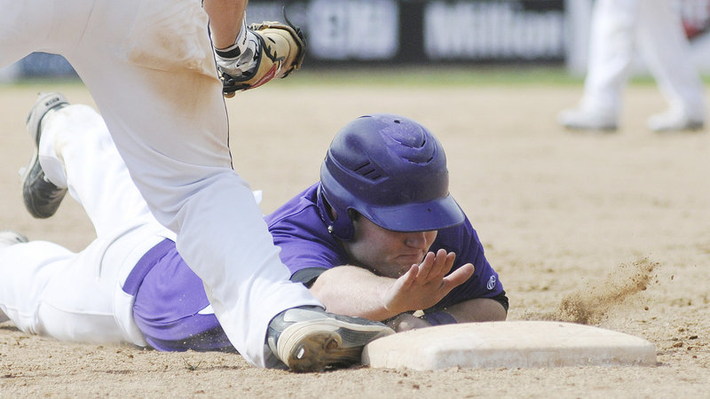 Devon Fitzgerald of Deering is picked off first base immediately after breaking up Scott Heath's no-hit bid with a single up the middle as a pinch hitter in the sixth inning.