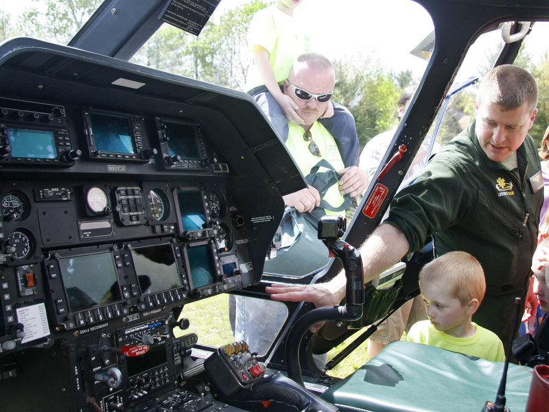 Pilot Scott Blake shows Ezekiel Lyons, 4, of Rochester, N.H., the cockpit of LifeFlight 2.