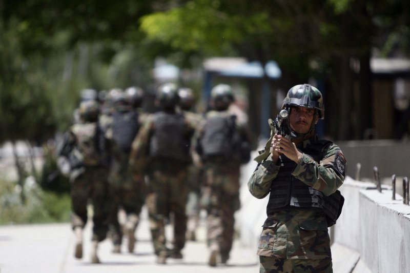 Afghan soldiers arrive Saturday at Kabul's main military hospital, where a suicide bomber blew himself up inside a tent filled with medical students, killing at least six people.
