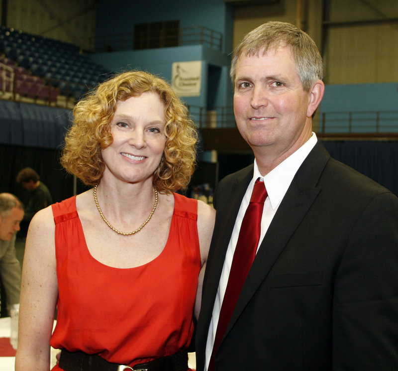 Doug Roberts, with his wife, Pam, was honored for his basketball accomplishments at Rumford High, which he led to two state titles and a New England championship.