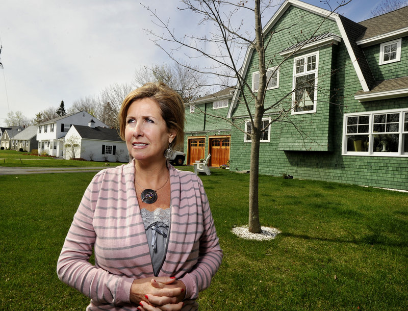 Lisa Mills and her husband, Wesley, had their longtime Kennebunk home rebuilt as a shingle-style cottage nearly a year ago by Doyle Enterprises.