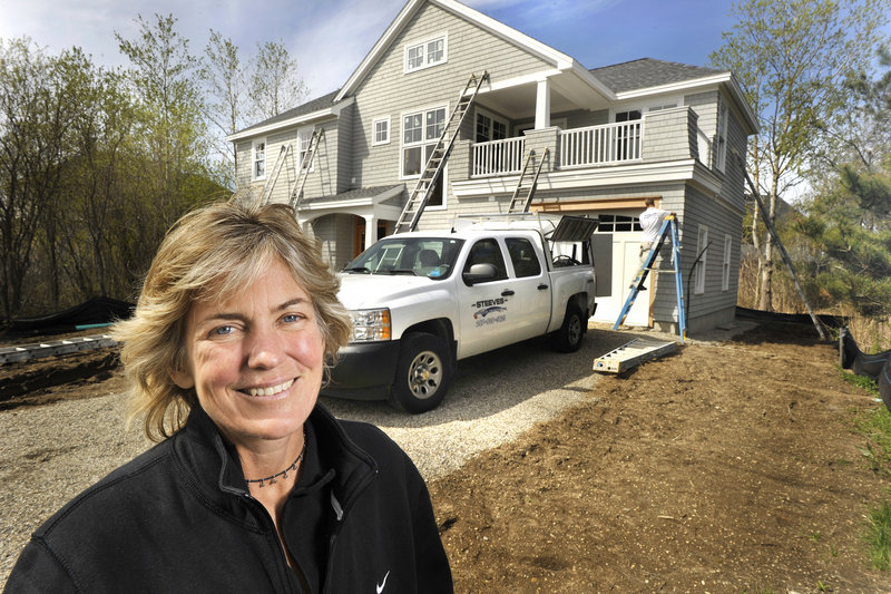 Diane Doyle, owner of Doyle Enterprises in Saco, has worked on 10 homes in a Kennebunk Beach neighborhood built on fill that is being turned into high-priced summer houses.
