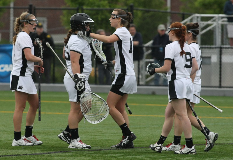 Bowdoin goalie Tara Connolly is consoled by her teammates following the Polar Bears' loss to Gettysburg in the NCAA Division III women's lacrosse championship game. The Polar Bears finished with a school-record 18 victories.
