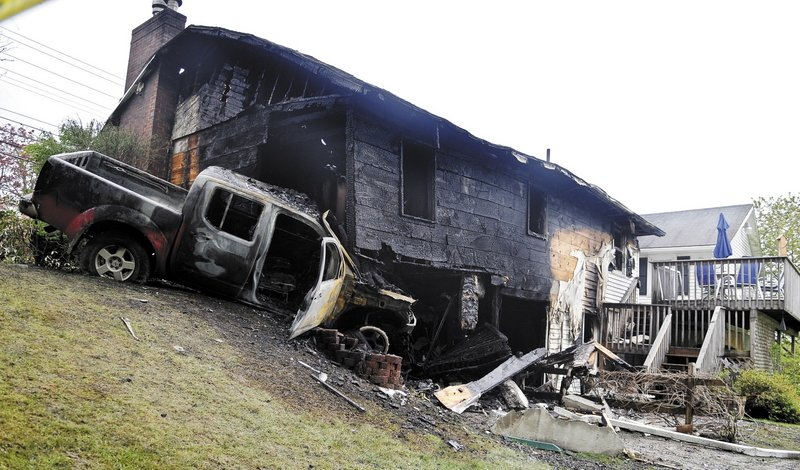 A pickup truck burst into flames Sunday after striking the home of Ken and Linda Ward on Riverside Drive in Augusta. Both the homeowners and the truck operator managed to flee the fire that destroyed the home and pickup.
