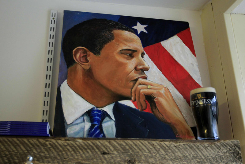 A painting of President Obama stands next to a replica pint of Guinness in a shop in Moneygall, Ireland, on Saturday. As part of his visit, Obama is expected to stop at a pub in Moneygall, the ancestral homeland of his great-great-great-grandfather.