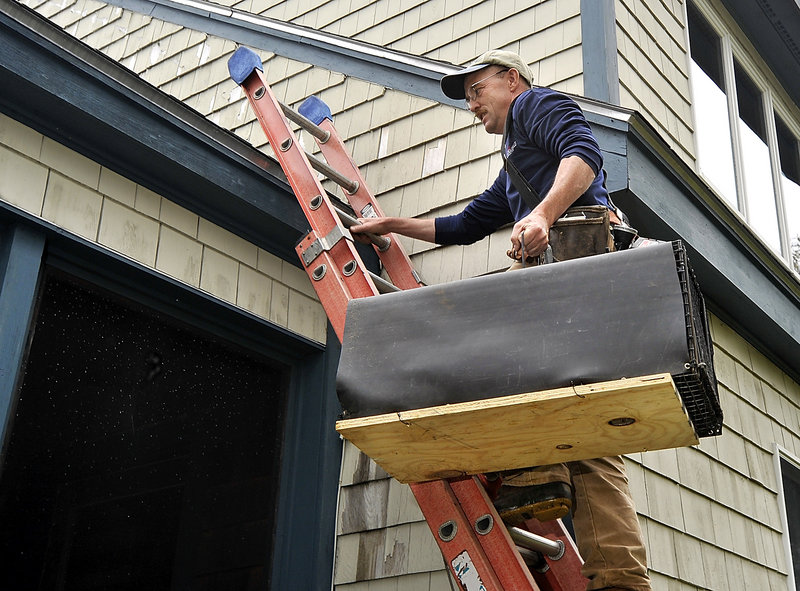 John Bourgoin was on the job in Fortune Rocks near Biddeford Pool this week, carrying a wire trap for extracting raccoons that settled in a house's attic through a vent.