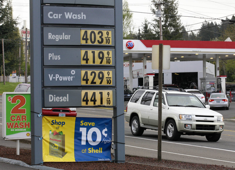 Prices like these in a photo taken earlier this month have fallen a bit, but people are still hard-pressed to pay them, readers say.