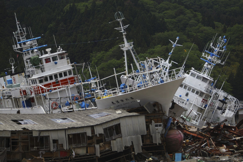 More than two months after an earthquake and tsunami devastated areas of northeastern Japan, fishing boats were still sitting on shore Tuesday in Kesennuma, Miyagi prefecture. The disaster left more than 24,000 people dead and damaged farms and ports.