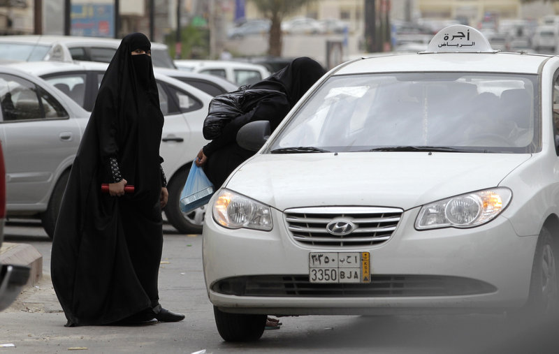 Saudi women can travel by taxi, as seen here, but a woman was arrested for a second time for driving her car in what activists say is suppression by the rulers of the conservative kingdom.