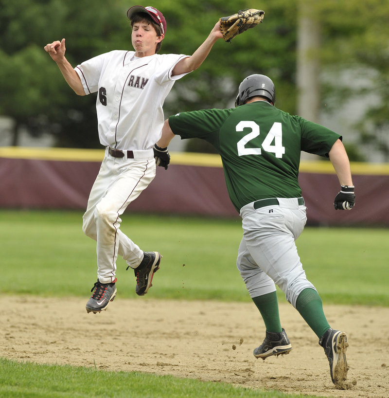 Second baseman Spencer LaPierre of Gorham snares a soft liner Tuesday as Nick Cawood of Bonny Eagle bears down on him. Bonny Eagle went on to a 17-5 victory in a Telegram League game at Gorham.
