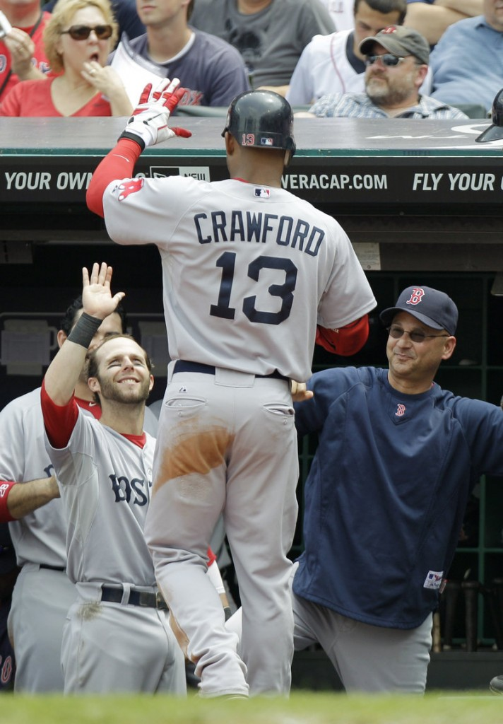 Carl Crawford, greeted by Dustin Pedroia, left, and Manager Terry Francona after hitting a solo home run in the fourth inning Wednesday, finally is coming around for the Boston Red Sox. He went 4 for 4 with two doubles, three runs and two RBI, and was 6 of 11 in the series against the Cleveland Indians.