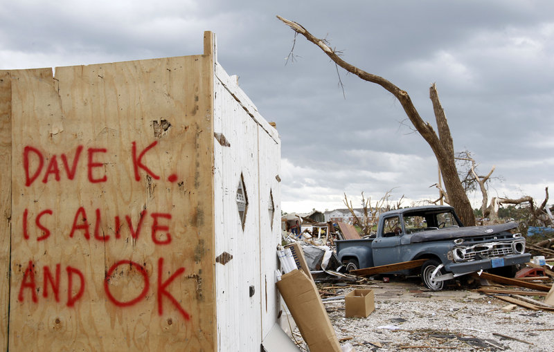 The Associated Press A reassuring message is seen on the side of a building Wednesday in Joplin, Mo.
