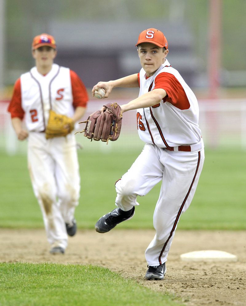 Nick Bagley, a second baseman who had both of Scarborough's hits in a 4-3 loss at home to Deering, readies to throw to first base Thursday after coming up with a slow roller.
