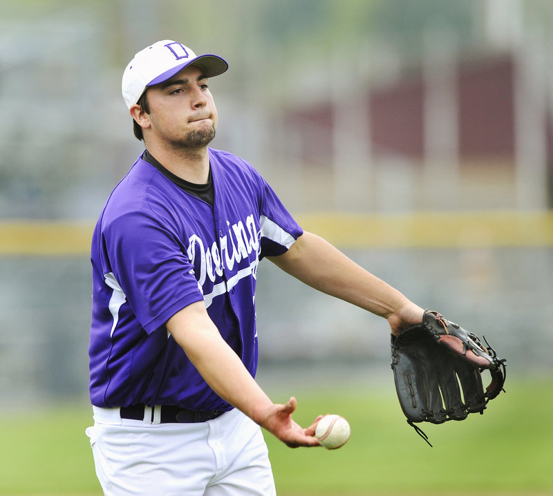 Deering pitcher Jamie Ross flips the ball to first base Thursday after coming up with a grounder during the 4-3 victory against Scarborough. Ross pitched a two-hitter and struck out 10 as the Rams improved their record to 11-2. Scarborough is 10-3.