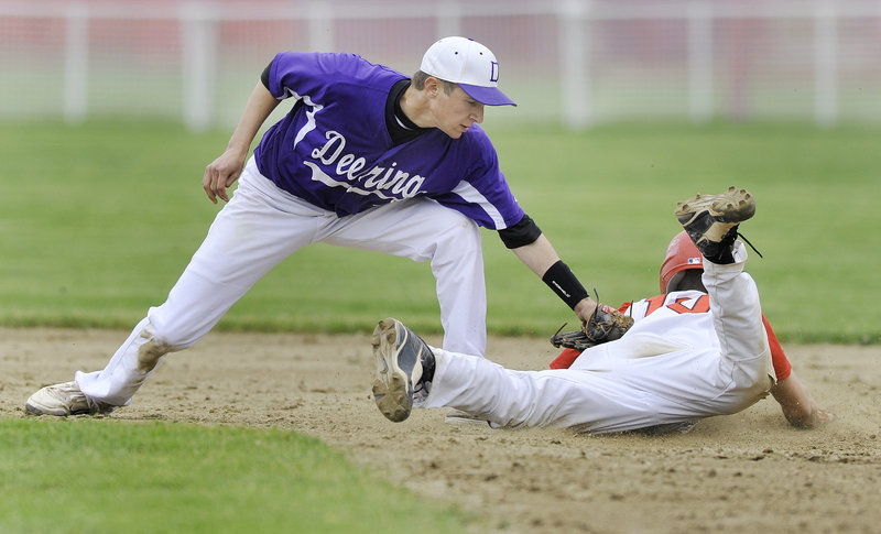 Deering second baseman Matt Bevilacqua applies the tag as Ryan Mancini of Scarborough is caught attempting to steal.