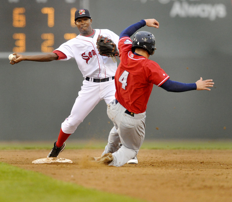 Second baseman Oscar Tejada throws to first after forcing Mark Sobolewski of New Hampshire in the fifth inning of the Sea Dogs' 13-7 loss Thursday night at Hadlock Field.