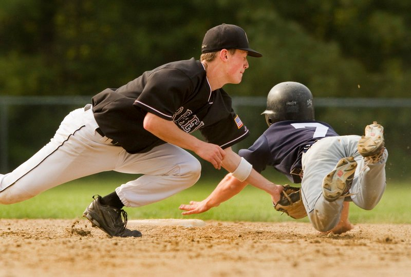 Second baseman Brad McKenney of Greely puts a tag on Max Grimm of Yarmouth in the fourth inning. Yarmouth improved to 12-3; Greely is 13-2.