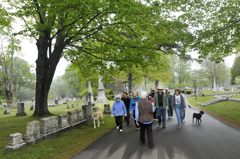 Janet Morelli leads a Civil War walking tour Saturday at Evergreen Cemetery in Portland as part of the 20th anniversary celebration of the Friends of Evergreen, a nonprofit caretaker organization. The 159-year-old cemetery was modeled after Mount Auburn Cemetery in Cambridge, Mass.