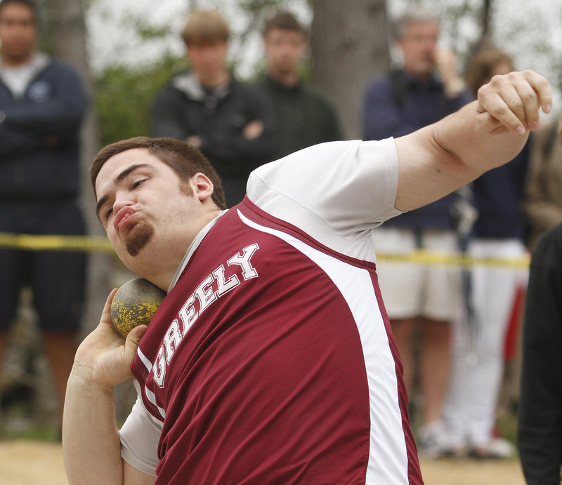 Michael Burgess of Greely, the boys' top large-school athlete in field events, unleashes a throw of 55 feet, 3 1/2 inches in the shot put to set the only new conference record of the day.