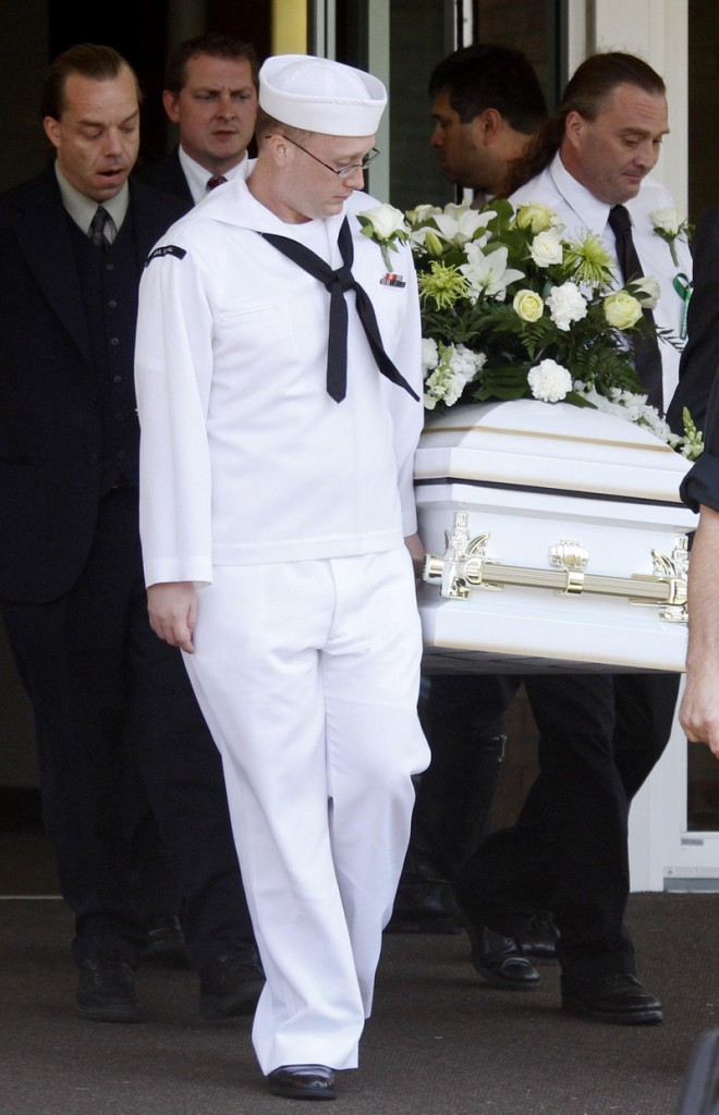 Ian McCrery, dressed in his Navy uniform, assists in carrying the casket for his younger brother, Camden Hughes at Saturday's memorial service.