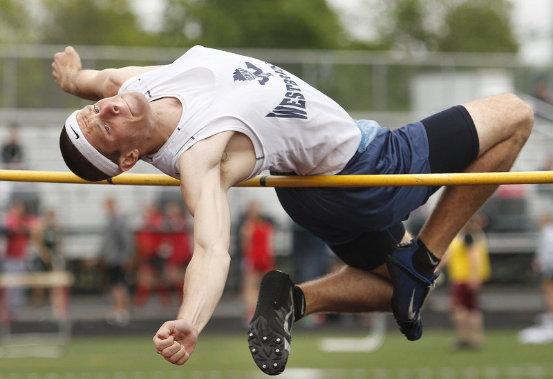 Zach Dugas of Westbrook stretches Saturday in an attempt to clear 6 feet in the high jump during the SMAA meet at Scarborough. Dugas placed third at 5-10. Malcolm Smith of Cheverus captured the event with a leap of 6 feet.